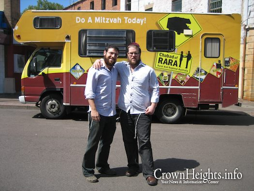 Yossi Spigler and Sholom Rapaport who volunteered as roving Rabbis in 2008, pose in front of the RARA Mitzvah Tank. Illustration Photo.