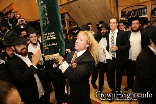 Mr. Leonardo Farkas dances with one of the Sifrei Torah during the 2013 International Kinus Hashluchim.