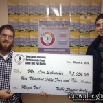 Picture of the Day: Lucky Winner Picks Up $5,000 Check