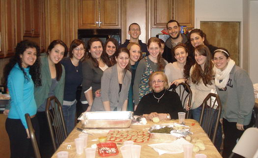 Drexel students help cook for a recent Shabbat meal at the local Chabad house, despite the compromised facilities.