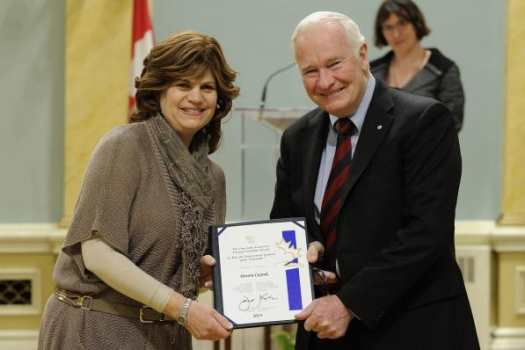 Mrs. Devora Caytak receives the Governor General's Caring Award.