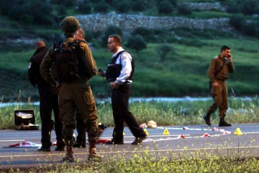 Israeli soldiers at the shooting site.