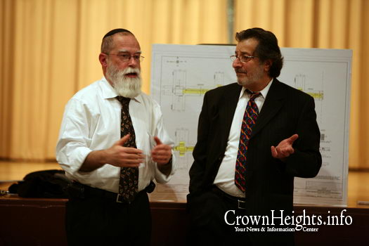 Rabbi Col. Jacob Goldstein (left) speaks with an architect at a zoning hearing in 2008.