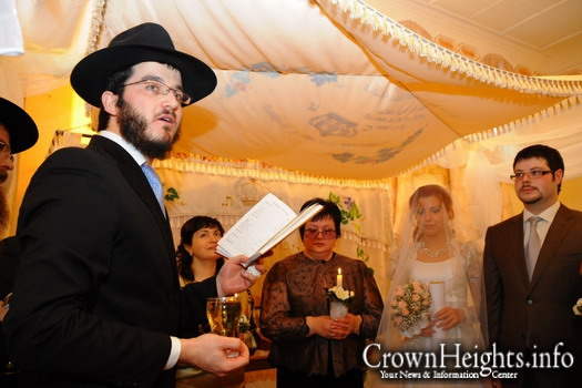 Rabbi Asher Krichevsky, Chabad emissary and chief rabbi of Omsk, a city in southern Siberia, officiates at a wedding.