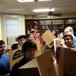 Teens Make Charity Boxes for Ukraine's Needy