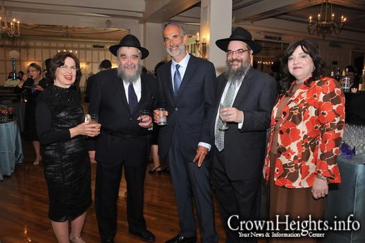 Mrs. Deitsch (far left) with her husband R' Mordechai Deitsch at this years Oholei Torah's dinner.