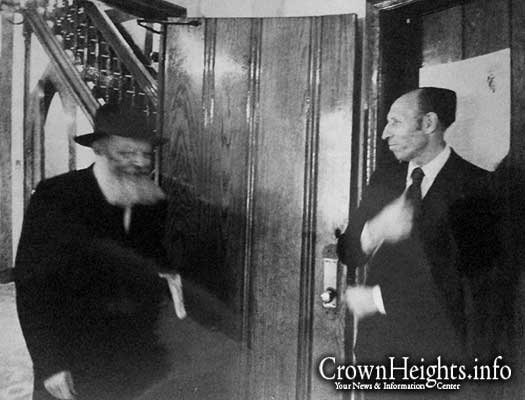 Pictured: Lieutenant Abraham Kushner greets the Lubavitcher Rebbe as he exits his room in 770.