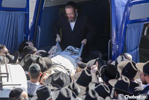The funeral of Shalom Aharon Badani, a 17-year-old yeshivah student who died after a terrorist rammed his minivan into a crowd waiting for a train in Jerusalem. Photo: Yonatan Sindel/Flash90.
