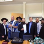 Ambassadors Puts on Tefillin for Terror Victims