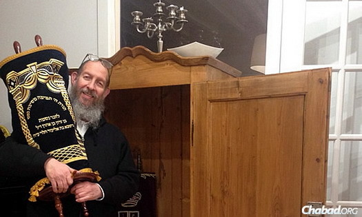 Chanowitz holds the small Torah named for the Israeli teens, which was sent to Chabad of the Big Island in Kailua Kona, Hawaii.