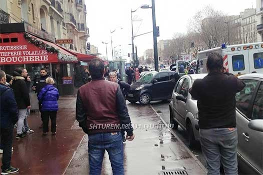 The scene outside a paris grocery store where a suspected terrorist