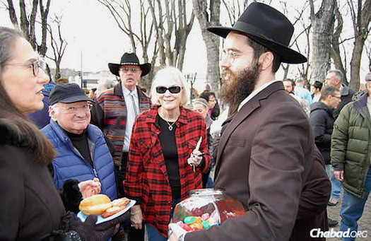 """We were a bit overwhelmed with the number of people who came,"" acknowledged the rabbi. Bracha Filler noted that when her husband recited the blessing, she marveled at how everyone joined in, adding that she ""got really emotional."" (Photo: Stan Katz)"