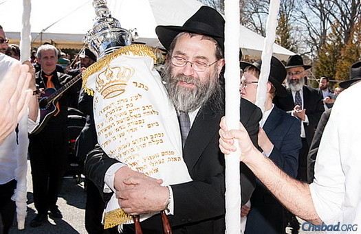 Rabbi Chaim Meir Lieberman, Rashi Minkowicz's father, holds the new Torah scroll in honor of his daughter, who passed away last year at the age of 37, as part of a communal Torah procession. (Photos: David Adler Photography and Deb Weidinger Art-Photograph-Design)