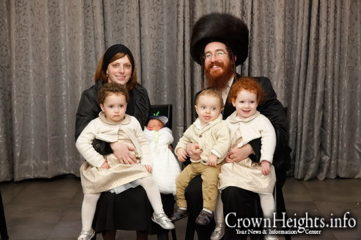 Yerachmiel Elimelech Weiss with his wife and four children.