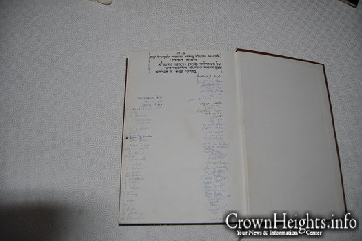 A signed Gemorah by all the members of the first charter flight to New York, with the Rebbe's signature on top.