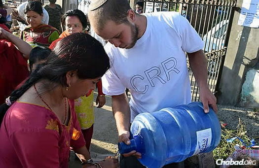 A band of volunteers—many of them young Israelis—are going from camp to camp distributing water, food, medicine, warm clothing, and most important of all, waterproof tents. They are led by Chani Lifshitz, co-director of Chabad of Nepal, with her husband, Rabbi Chezky Lifshitz.