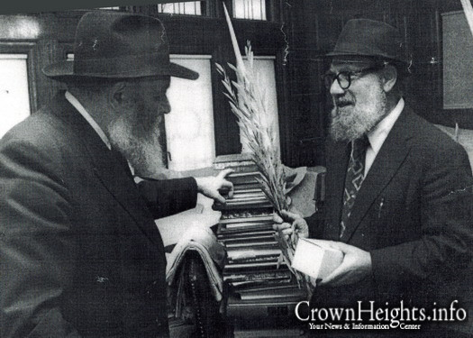 Rabbi Nissan Mindel receiving a set of Lulav and Esrog from the Rebbe.