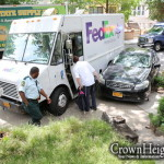 FedEx Driver Loses Control, Smashes Parked Car