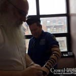 Picture of the Day: Officer Dons Tefilin
