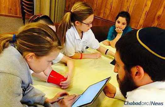 Hebrew-school students review their reading using cutting-edge computer programs and apps.