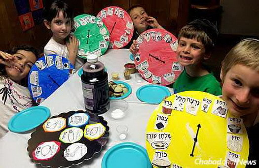 Children at Chabad show off their Passover seder plate dials.