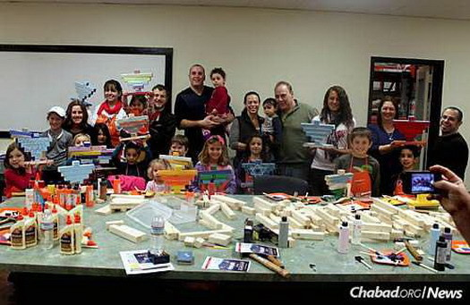 Chattanooga Jewish community members participate in an Office Depot workshop at Chanukah time.