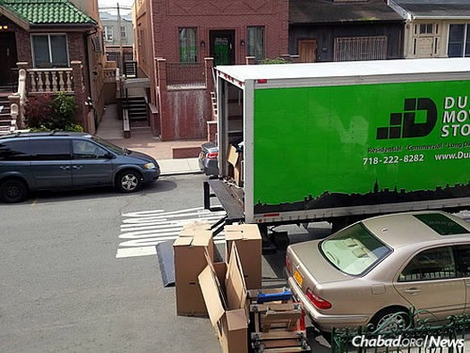 The moving truck outside the Kazens' former home in Brooklyn, N.Y.