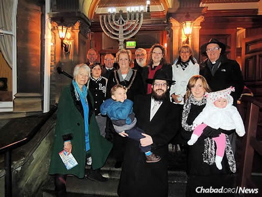 The Roses with Jones, and local parliament members, assembly members and religious leaders at the city's first public Chanukah menorah-lighting on Dec. 21, 2014, in front of the Mansion House, the official residence of the Lord Mayor of Cardiff.