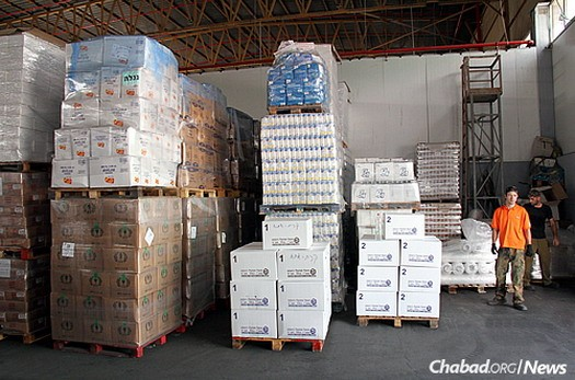 In addition to boxes of holiday goods, stored in an enormous warehouse, vouchers to purchase items like chicken and even new children's clothing are also being given out as part of the distribution.