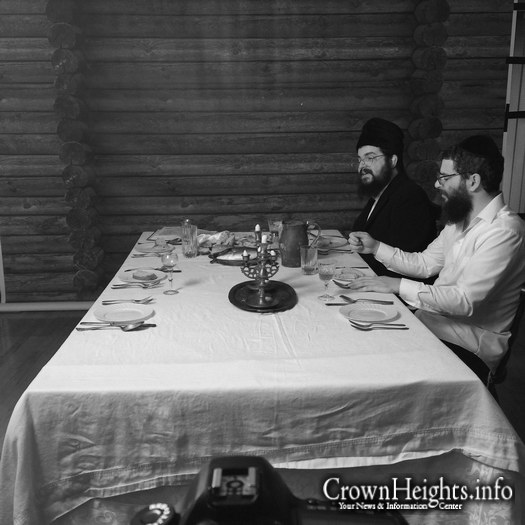 Benny Friedman (far) with Chaim Hershkowitz filmingon set.