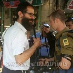 Picture of the Day: Satmar Rebbe's Great-Grandson Puts on Tefilin