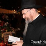 Russia's Chief Rabbi Lights Candle at French Embassy