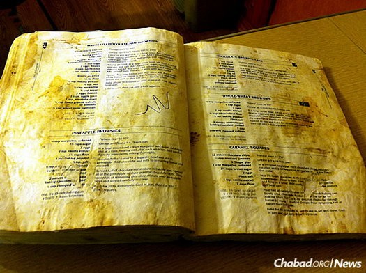 The book became glued to Jewish kitchens; the typical volume is replete with handwritten notes, food stains and flour smudges.