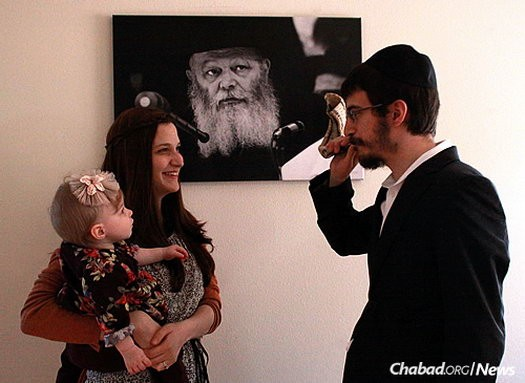 The rabbi blows shofar for his wife and baby daughter during the month preceding Rosh Hashana.
