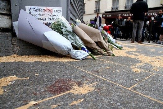 The Le Petit Cambodge restaurant with a makeshift memorial of flowers, the day after the attacks.