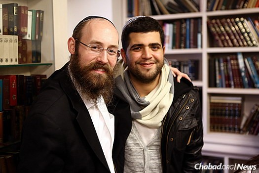 Rabbi Shneur Simcha Landa, who co-directs Chabad at Netanya Academic College in Israel, with a student there.