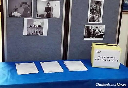 Students have been gathering at a booth on campus to light candles, share memories, gain strength from each other and select mitzvahs that they are pledging to do in memory of their friend.