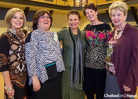 Shiffy Landa, second from left, was recently honored with the Jewish Professionals of St. Louis (JProStl) Career Achievement Award.