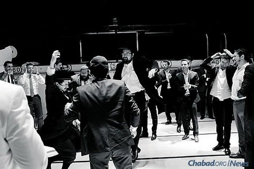 The Chassidic and the hip meld at a simcha in the Borough of Outremont in Montreal, Canada. Bearded and dancing at the center right is Rabbi Yudi Winterfeld, co-director of Chabad Mile End.