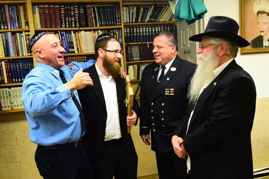 [Left to Right] Firefighter Joseph Scaramuzzino, Rabbi Zalman Feldman, firefighter Lieutenant Ralph Tufano and Rabbi Yehuda Friedman.