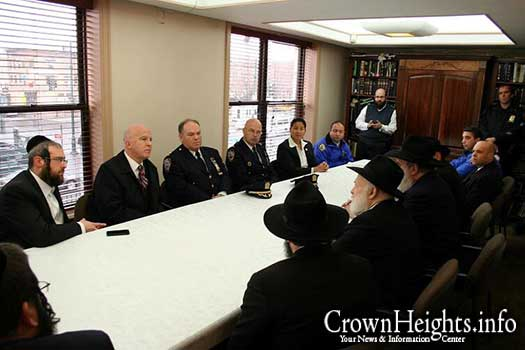 Inspector George Fitzgibbon at a meeting with Rabbi Yehuda Krinsky of Merkos Linyonei Chinuch.
