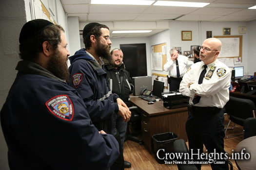 Inspector George Fitzgibbon meeting with Shomrim volunteers and discussing the safety and security of Crown heights.