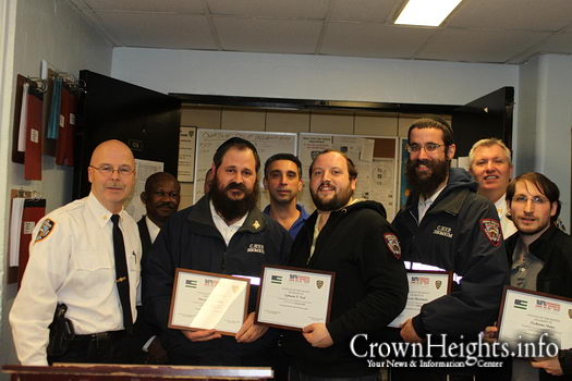 Inspector George Fitzgibbon awarding Shomrim Volunteers with Citizen of the Month Award following their successful apprehension of a pair of muggers.