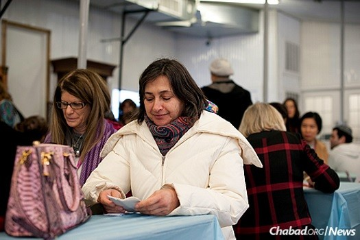 Rimma Alexeeva, 63, visited the Ohel for the first time on Sunday as part of the four-day International Conference of Chabad-Lubavitch Female Emissaries (Kinus Hashluchos) in Brooklyn, N.Y. (Photo: Bassie Vorovitch)