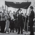 Picture of the Day: Survivor Dances with Victims' Torah