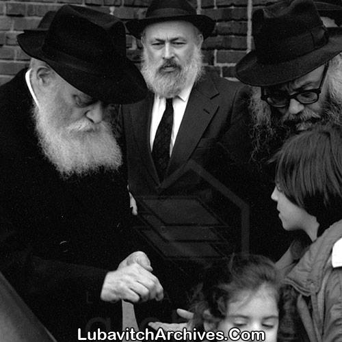 The Rebbe on that fateful day before going to the Ohel, as Rabbi Yehudah Krinsky stands beside him.