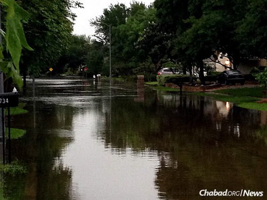 A flooded street in a Jewish neighborhood just days before the start of Passover.