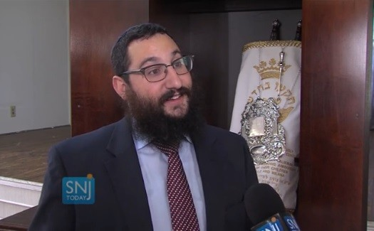 Rabbi Avi Richler, director of Chabad of Gloucester County, with the new Torah.