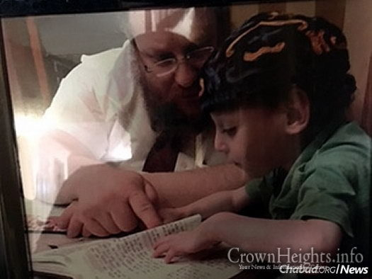 Rabbi Mendel Samuels—co-director of Chabad of the Farmington Valley in Weatogue, Conn., with his wife, Blumie—studies with his youngest child, Meir, who has a rare genetic disease called Familial dysautonomia.
