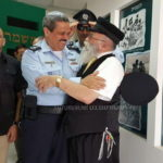 Picture of the Day: Activist and Top Cop Embrace